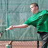 Don Knight/The Herald Bulletin<br /> Anderson's Joe Moran returns a volley to Frankton's Lucas Bolt in the semi-final round of the county boys tennis tournament at Highland on Thursday.