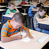 Don Knight/The Herald Bulletin<br /> First grader Kaiden Friesen, 6, completes a worksheet at Indiana Christian Academy on Friday.