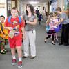Don Knight/The Herald Bulletin<br /> Teachers say goodbye to their students as they release them to their parents at the endo fot he first day of school at Anderson Christian School on Monday.