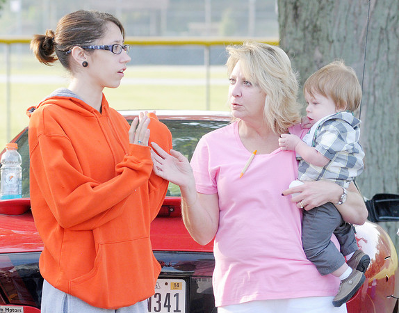 Don Knight/The Herald Bulletin<br /> From left, Jordan Bragg's girlfriend Kelsey Parrish and his mother Kelly Bragg, who is holding Kelsey and Jordan's son Keighton Bragg,  brief volunteers gathered Saturday morning in Middletown to search for Jordan Bragg, who has been missing since last Sunday.