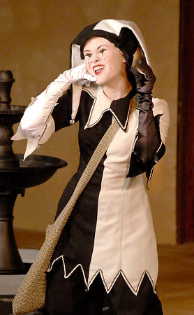 The Jester, played by Maggie Williams, facilitates the action of the play with expressive faces and gestures.