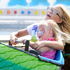 Don Knight/The Herald Bulletin<br /> Keeton Rogers, back, and Adriana Fetz ride a kids sized roller coaster during the Elwood Glass Festival on Saturday.