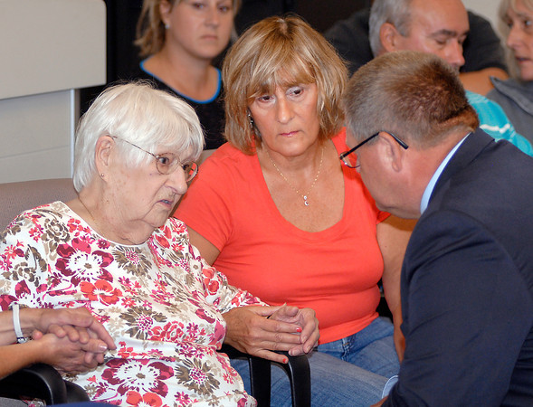 93 year old assault victim Amelia Rudolf talks with Anderson Police Chief Larry Crenshaw as her daughter Carol Fite holds her hand before the start of a news conference about formal charges being filed in her case.