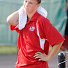Don Knight/The Herald Bulletin<br /> Anderson's Nick Whitaker wipes sweat from his face and neck between games  as Anderson faced Frankton in the semi-final round of the county boys tennis tournament at Highland on Thursday. Read about who will advance to the finals on B1.