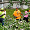Students at The Crossing were working with other Crossing students from northern Indiana to cut down several trees in the 2400 block of Dewey Street as a community service.