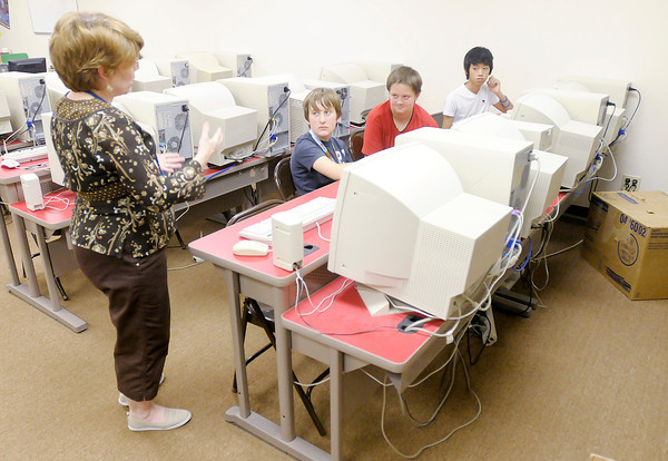 Don Knight/The Herald Bulletin<br /> Kim Vallance explains to her students the procedure for shutting down the computers in the computer lab during the first day of school at Anderson Christian School on Monday.