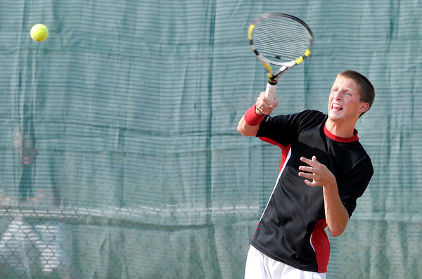 Don Knight/The Herald Bulletin<br /> Frankton's Lucas Bolt returns a volley to Anderson's Joe Moran in the one singles match  in the semi-final round of the county boys tennis tournament at Highland on Thursday.