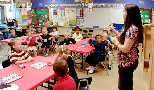 Killbuck School kindergarten teacher Michelle Lusher gives her new students  classroom instructions on their first day of school Wednesday.