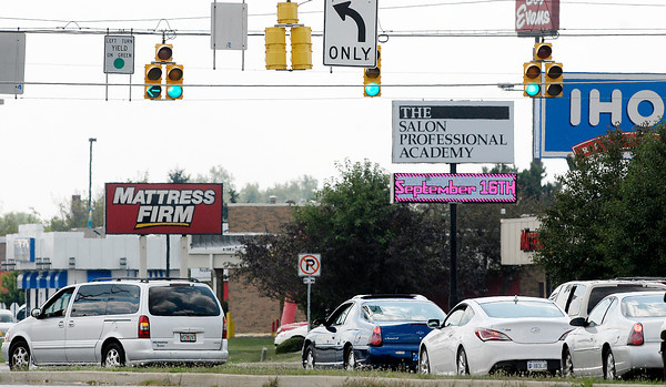 Vehicles turn east onto 53rd Street on the green turn arrow from southbound Scatterfield Road Monday afternoon.