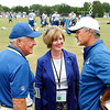 Congresswoman Susan Brooks, R-District 5, was in Anderson Monday to visit with local business leaders and then paid a visit to Colts Training Camp for their afternoon practice with her family.  Here Brooks, along with her father Bob Wient of Fort Wayne, left, talk football with Colts head coach Chuck Pagano.