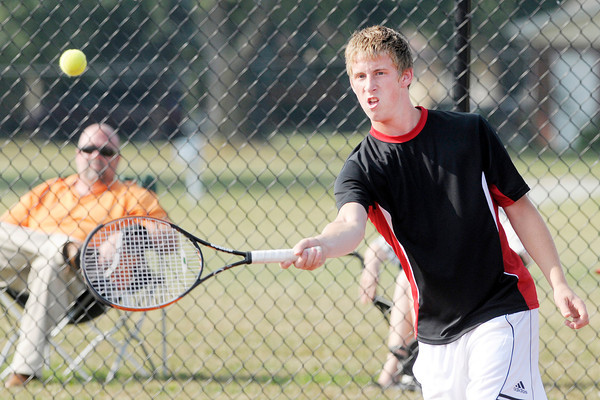 Don Knight/The Herald Bulletin<br /> Frankton's Blaine Reed returns a volley as Reed and partner Cameron Bates faced Anderson's Zack Abbott and Jason Kabir in the one doubles match in the semi-final round of the county boys tennis tournament at Highland on Thursday.