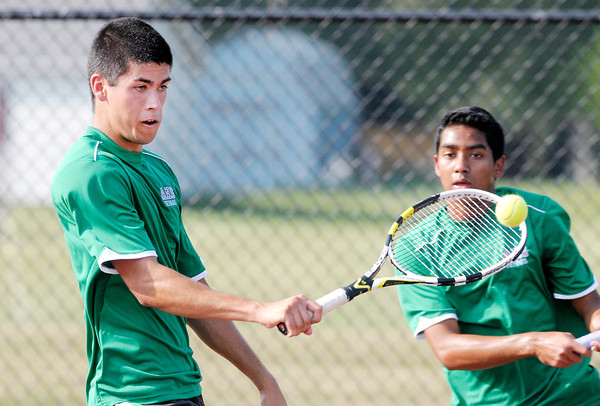 Don Knight/The Herald Bulletin<br /> Anderson's Zack Abbott returns a volley as his partner Jason Kabir looks on as they faced Frankton's Cameron Bates and Blaine Reed in the one double match during the semi-final round of the county boys tennis tournament at Highland on Thursday.