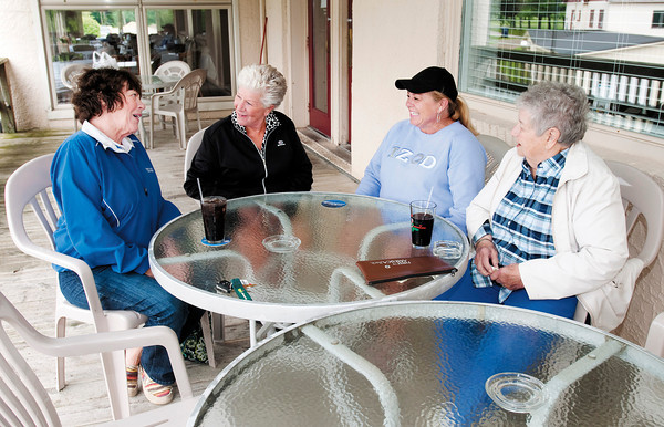 From left, Barb Lazenby, Cinda Brooks, Kristi Worley and Esther Myers sit on the deck at Rigo's at Grandview after a round of golf.