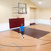 Isaiah and Joshua Tufts shoot around on the basketball court in the Tufts family home in Pendleton.