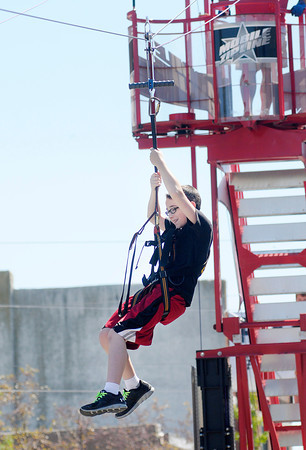 "Don Knight/The Herald Bulletin<br /> Reed Ellis, 12, of Alexandria rides zip line that was part of the Alexandria Grand Prix festivities on Saturday. ""It was pretty awesome,"" Ellis said when asked about the zip line."