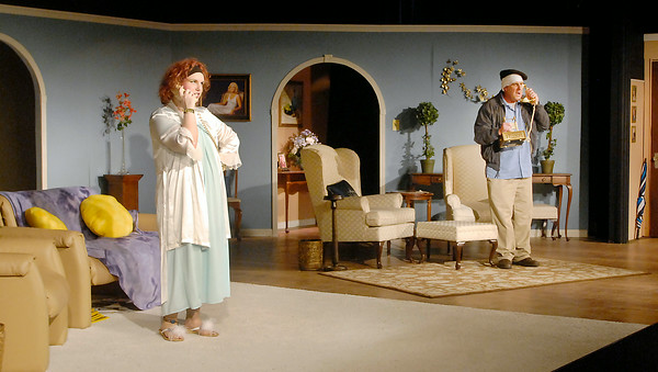 """John P. Cleary   The Herald Bulletin<br /> Wife No. 2 Barbara Smith (Tiffany Jackson) talks to her husband John Smith (Andrew Persinger)on the phone as he tries to keep his double life from her things during """"Run for Your Wife"""" at Mainstage Threatre.<br /> To view or buy this photo and other Herald Bulletin photos, visit<br /> photos.heraldbulletin.com."""