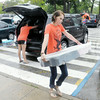Don Knight | The Herald Bulletin<br /> Maggie Liston helps new students move in to the dorms at Anderson University on Thursday. To view or buy this photo and other Herald Bulletin photos, visit photos.heraldbulletin.com.