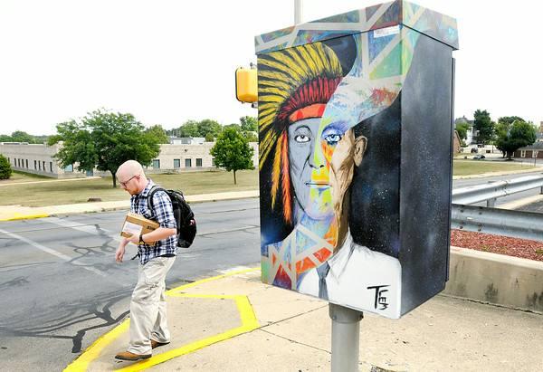 Don Knight | The Herald Bulletin<br /> A pedestrian walks past a traffic box painted by Tanner Lemon at 9th and Central on Monday. To view or buy this photo and other Herald Bulletin photos, visit photos.heraldbulletin.com.