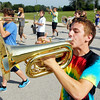John P. Cleary | The Herald Bulletin<br /> Lapel High School sophomore Torsten Wood, foreground, plays his horn as the Lapel High School Marching Band practices for the upcoming State Fair Band contest Saturday.