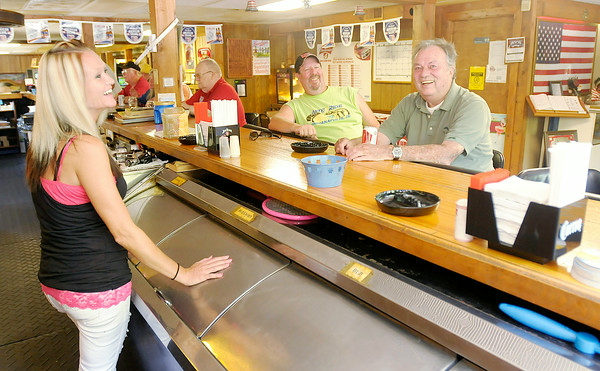 Don Knight | The Herald Bulletin<br /> From left, Bartender Marissa Smith talks to Chris Walker and Bud Hendricks <br /> at the Veterans of Madison County Club on East 10th Street in Anderson. The club has a membership around 400.