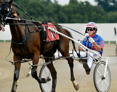 John P. Cleary | The Herald Bulletin Driver Trent Stohler heads back to the barn area after finishing fourth in the first race of the card Saturday afternoon at Hoosier Park.