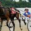 John P. Cleary   The Herald Bulletin<br /> Driver Trent Stohler heads back to the barn area after finishing fourth in the first race of the card Saturday afternoon at Hoosier Park.
