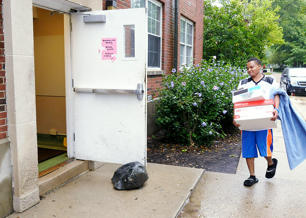 Don Knight | The Herald Bulletin<br /> Marcus Johnson, a film and media arts student from Gary Ind., moves into Dunn Hall on Thursday. To view or buy this photo and other Herald Bulletin photos, visit photos.heraldbulletin.com.