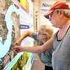 John P. Cleary | The Herald Bulletin<br /> Diana Schlabach and Bob Miller look for their property near Mounds State Park on a detailed map of the proposed Mounds Lake Reservoir through Anderson Tuesday at Mounds Mall at the first of several public sessions being held in Anderson, Chesterfield, Daleville, and Yorktown.  The proposed lake would run from Anderson to Yorktown along White River.