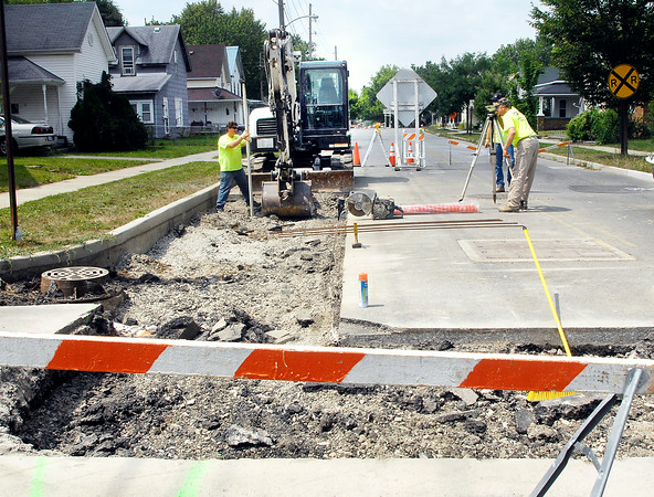 John P. Cleary | The Herald Bulletin<br /> Crews from RAM Engineering & Construction from Louisville, Ky. work along West 3rd Street St. Morton Street this past week to repair the collapsing pavement in the East-bound lane from previous work that has been done at the site.