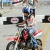John P. Cleary   The Herald Bulletin<br /> Chloe Eastwood, 7, gets her first experience riding a motorcycle as dad, Chad Eastwood, takes her photo at the ABATE of Indiana's Tiny Tots Motorcycle Adventure during the City Wide Community Day at Dickmann Town Square.