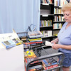 Don Knight | The Herald Bulletin<br /> Karen O'Neill sorts through new arrivals at The Book Nook in the Mounds Mall. Books are $2 with proceeds used to provide free literacy services to local adults and children. To view or buy this photo and other Herald Bulletin photos, visit photos.heraldbulletin.com.