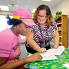 John P. Cleary | The Herald Bulletin<br /> Tamekia Fleming goes over information with First Call Staffing regional manager Electra Young as she goes through orientation for new employees.