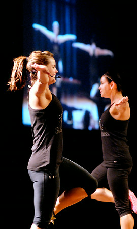 John P. Cleary | The Herald Bulletin<br />  Fitness Sisters Hillary Novak and Natalie Farmer lead their Zumba class at Madison Park Church of God.  To view or buy this photo and other Herald Bulletin photos, visit<br /> photos.heraldbulletin.com.