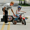 John P. Cleary   The Herald Bulletin<br /> Chloe Eastwood, 7, gets her first experience riding a motorcycle, with a little help from dad Chad Eastwood, at the ABATE of Indiana's Tiny Tots Motorcycle Adventure during the City Wide Community Day at Dickmann Town Square.
