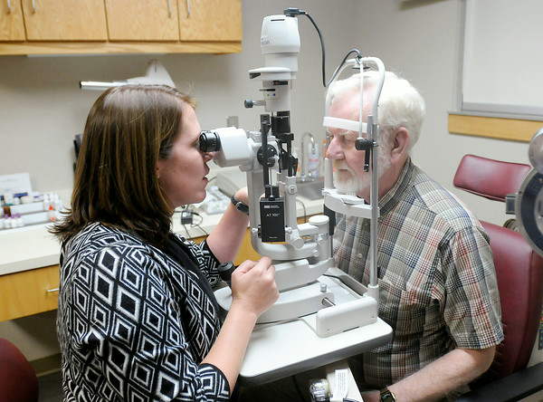 Don Knight | The Herald Bulletin<br /> Dr. Elizabeth Groves checks Wayne Liston's eyes at the Anderson Center for Sight on Friday. To view or buy this photo and other Herald Bulletin photos, visit photos.heraldbulletin.com.