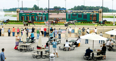John P. Cleary | The Herald Bulletin Race fans line the fence to watch the finish of the third race on the card Saturday afternoon at Hoosier Park Racing & Casino.