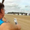John P. Cleary   The Herald Bulletin<br /> Bob Bellamy watches his horse Red Scooter come by the grandstand the first time during the second race at Hoosier Park Saturday afternoon.