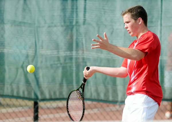 Don Knight | The Herald Bulletin<br /> Anderson's Joe Moran returns a volley to Frankton's Conner Bates as Anderson hosted Frankton during the Madison County Tennis Tournament on Wednesday. To view or buy this photo and other Herald Bulletin photos, visit<br /> photos.heraldbulletin.com.