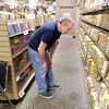 Don Knight | The Herald Bulletin<br /> Bob Edwards looks through the selection at The Book Nook in the Mounds Mall. Books are $2 with proceeds used to provide free literacy services to local adults and children. To view or buy this photo and other Herald Bulletin photos, visit photos.heraldbulletin.com.
