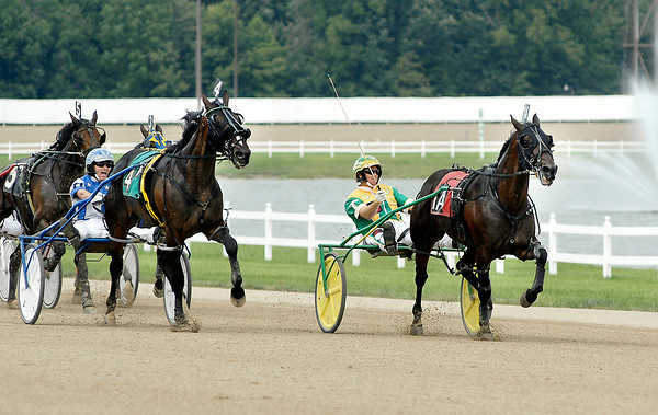 John P. Cleary | The Herald Bulletin Trace Tetrick, right, holds off a charging Ed Hensley down the stretch to win the first race of the day Saturday afternoon at Hoosier Park.