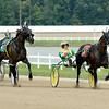 John P. Cleary | The Herald Bulletin<br /> Trace Tetrick, right, holds off a charging Ed Hensley down the stretch to win the first race of the day Saturday afternoon at Hoosier Park.