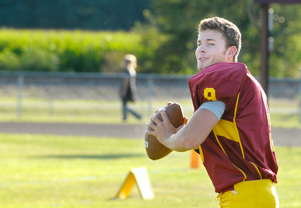 Don Knight | The Herald Bulletin<br /> Quarterback Blaize Kelly warms up on the sideline as Alexandria-Monroe hosted Southern Wells for a scrimmage on Friday.