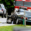 John P. Cleary | The Herald Bulletin<br /> Madison County Sheriff Department investigators  gather information at the scene of a fatal head-on collision involving a car and a flatbed truck in the 9100 block of North Indiana 37 near Elwood Thursday morning.