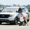 "Don Knight | The Herald Bulletin<br /> Chesterfield police officer Adam Rue apprehends a suspect portrayed by Wes Owen as his is covered from left by Sgt Nasel Road and Jeff Stigall during a simulated traffic stop of a dangerous suspect during training at the Anderson Municipal Airport on Thursday. Chesterfield Police Chief William Ingles and Cpt. Jim Cleaver with the Sheriff's Department organized the training for local law enforcement at the Anderson Municipal Airport and the Millcreek Civic Center. The state mandated training covered several topics and included an Emergency Vehicle Operations Course set up at the airport. Over 125 officers from several local agencies received training in four hour blocks over three days. ""We all work together why not train together,"" said Chief Ingles. Having the training available locally also saves departments the expense of sending officers to the Academy for the mandated refresher training."
