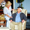 "John P. Cleary | The Herald Bulletin<br /> Mary Smith (Kimberly Rae Graham), wife No. 1, consoles her husband John Smith (Andrew Persinger) after he comes home from the hospital after being hit on the head during Mainstage Theatre's production of ""Run for Your Wife.""<br /> To view or buy this photo and other Herald Bulletin photos, visit<br /> photos.heraldbulletin.com."