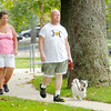 Don Knight | The Herald Bulletin<br /> Joe and Laura Neill walk their dog Maggie on Tuesday at Falls Park in Pendleton.Tuesday was National Dog Day. The day was originated by author Colleen Paige in 2004 to bring attention to dogs needing to be adopted and highlight how dogs improve our lives according to NationalDogDay.com.