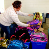 John P. Cleary | The Herald Bulletin<br /> Caitlin McGuire and Gabby Carmack sort out packpacks which were given away to students at the annual Ollie Dixon's Back to School Parade and Picnic Saturday.