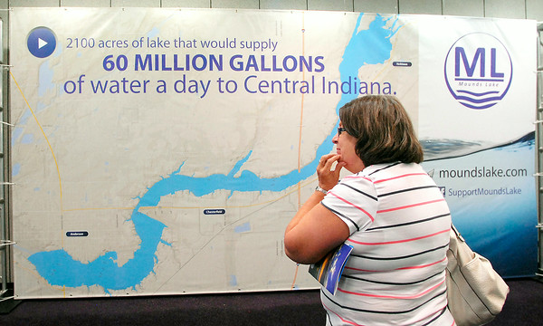 John P. Cleary | The Herald Bulletin<br /> Bonnie Cox of Chesterfield studies the large map of the proposed Mounds Lake Reservoir Tuesday at Mounds Mall at the first of several public sessions being held in Anderson, Chesterfield, Daleville, and Yorktown.  The proposed lake would run from Anderson to Yorktown along White River.