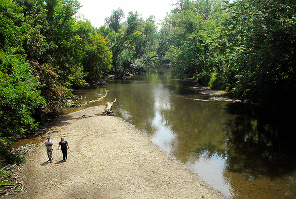 John P. Cleary | The Herald Bulletin<br /> This couple walk down a gravel bar along White River just down river from the old iron bridge on County Road 300 South in Delaware County.  This stretch of the river would be affected by the proposed Mounds Lake Reservoir.