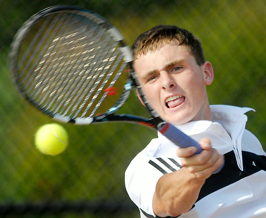 John P. Cleary | The Herald Bulletin<br /> Lapel's Garrett Fensler follows through with a forehand shot during his #1 singles match against Alexandria's Josh Deutsch in the Madison County Tennis Tourney championship round Friday.